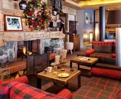 living room chimney hotel les gets